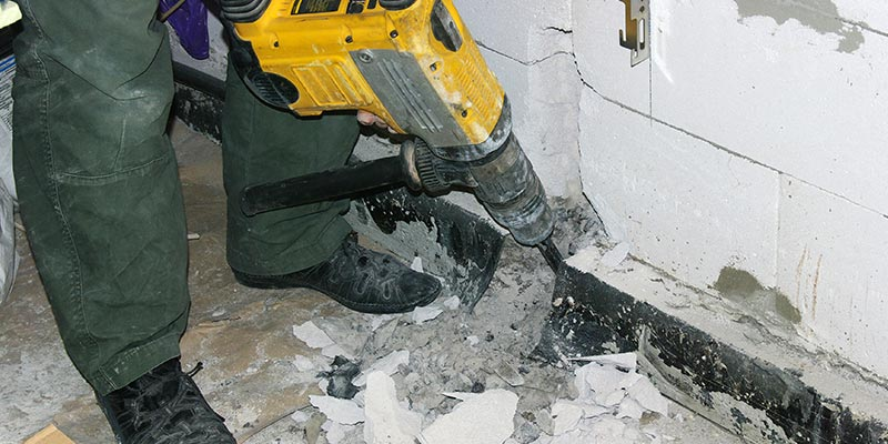 Rotary Hammer Being Used to Break Apart a Wall.