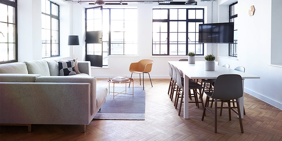 Naturally Lit Apartment with Modern Flooring and Large Windows