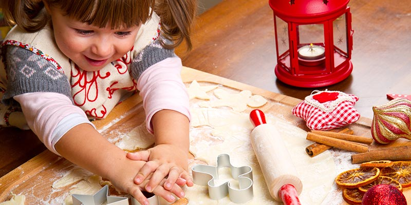 Little Girl Cutting Out Holiday Cookies