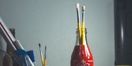 Reusing a Coke bottle as pencil holder.