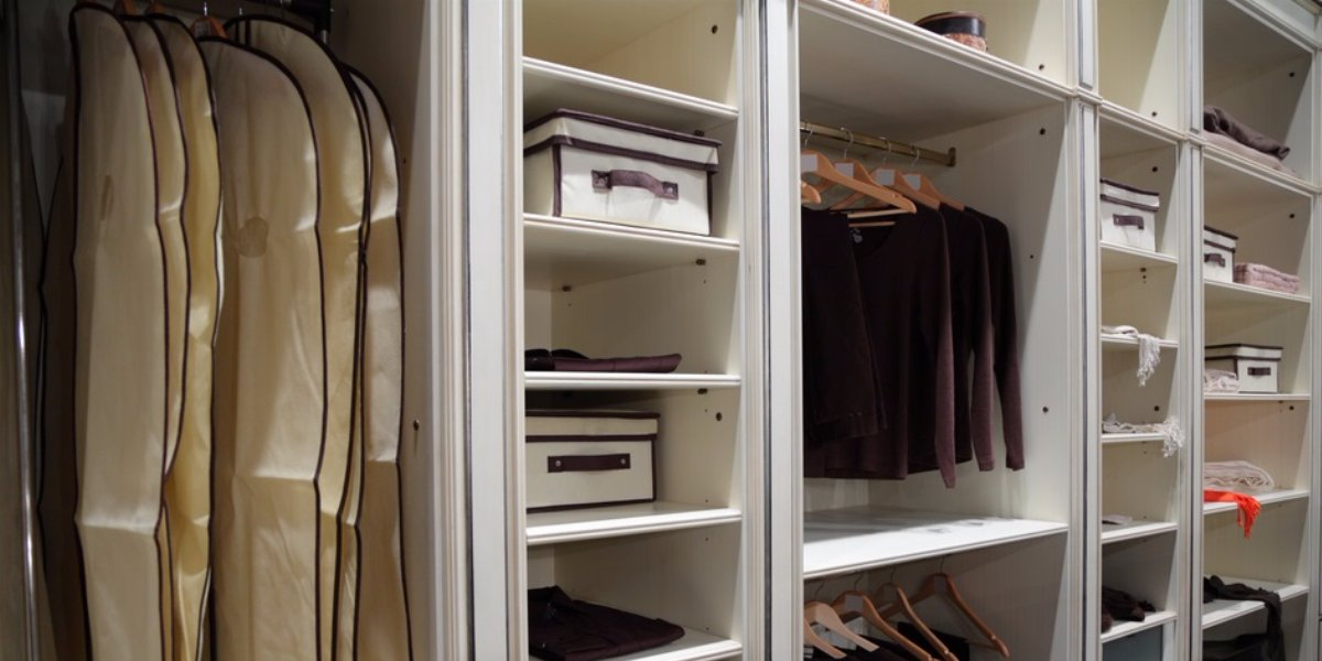 Organized master bedroom closet.