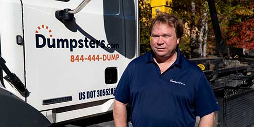 COO of Cleveland Hauling Operations Rich Gersdorf Standing Next to a Dumpsters.com Truck.
