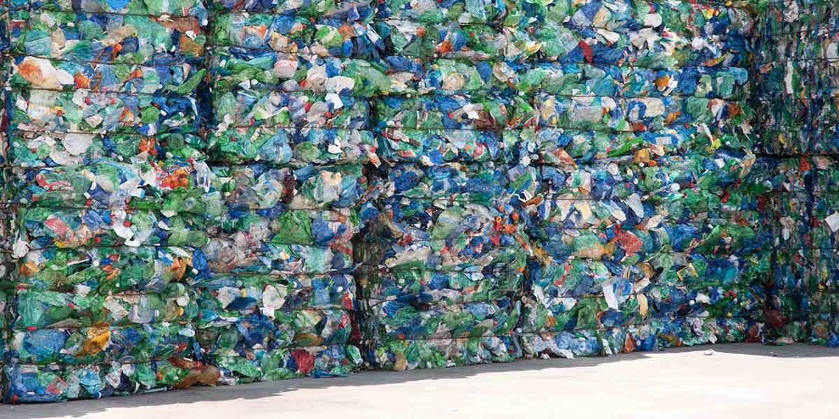 Stacks of Recyclable Materials Waiting at a Recycling Facility.