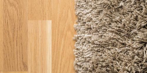 Hardwood and Carpet Flooring Sitting Side-By-Side.