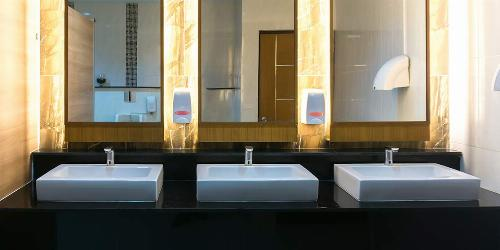Commercial Restaurant Bathroom With Three Modern Sinks and LED Lighting