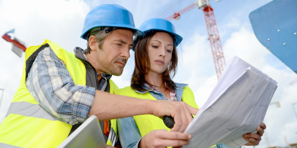 Construction Workers Reviewing Quality Plans
