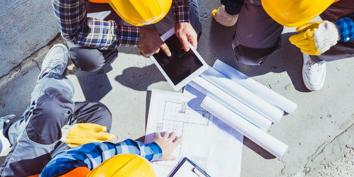 Construction Project Manager Talking With Subcontractors