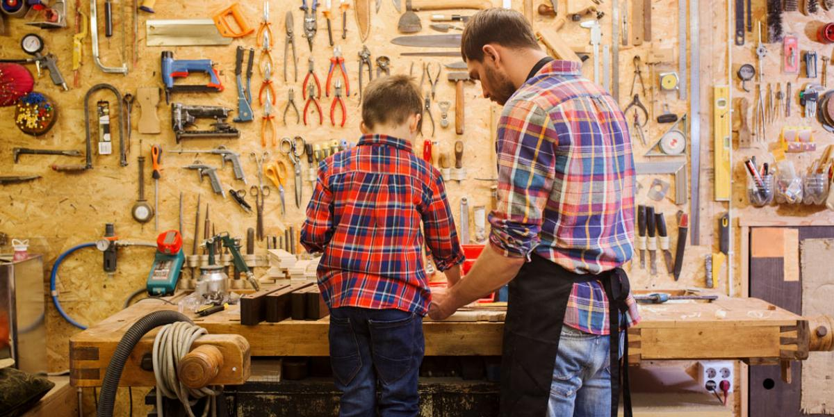 Father and Young Son at Garage Workbench