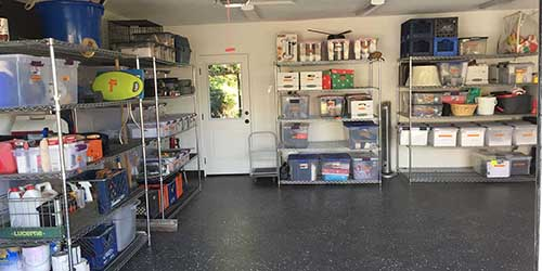 Garage Organized with Shelving Units and Storage Containers.