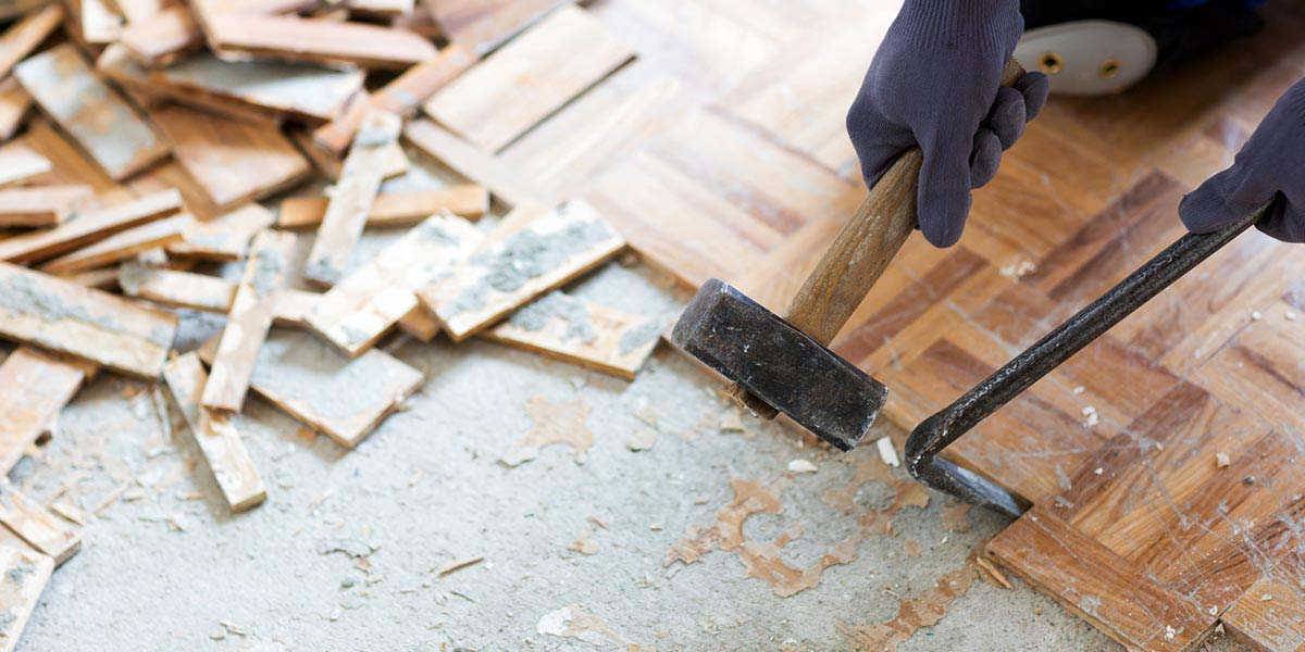 hammer and crowbar removing floor