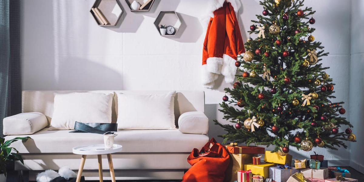 White Room With Minimalist Furniture and a Christmas Tree With Presents