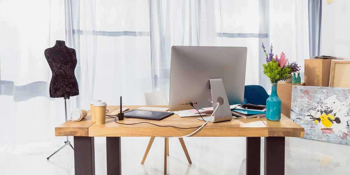 Desk With Mild Clutter in a Home Office. Source: Deposit Photos