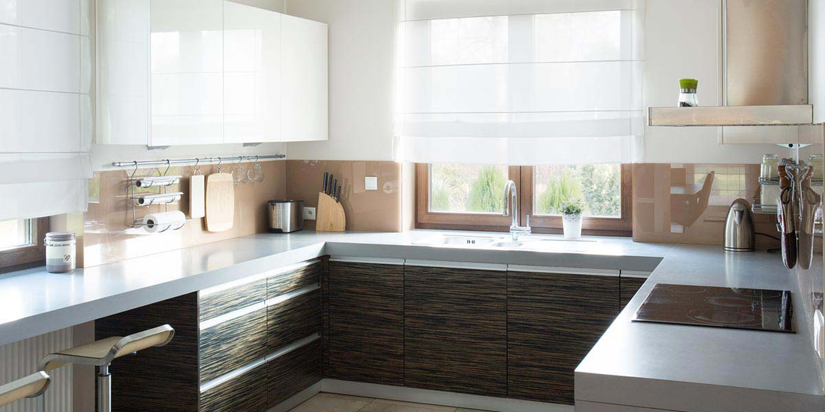 Clean, Modern Kitchen With Sleek White Counters.