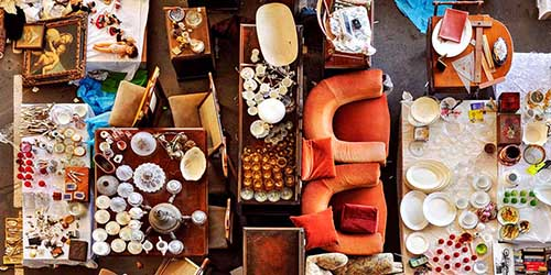 Birds Eye View of Dishes, Furniture and Odds and Ends Displayed at a Garage Sale.