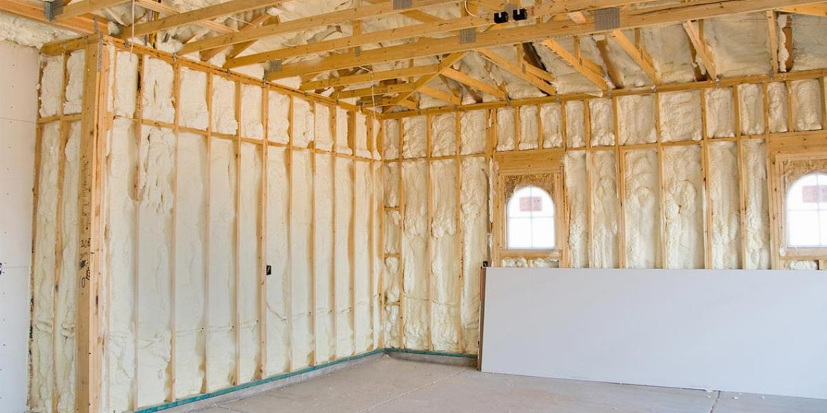Inside of Garage With Studs Filled With Insulation | How to Insulate a Garage