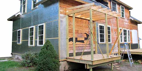 Two-Story Home with Small Room Being Built Onto the Side.