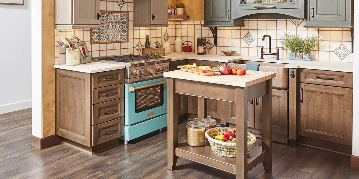 Bright Kitchen With Two-Tone Cabinets, Turquoise Stove and Island.