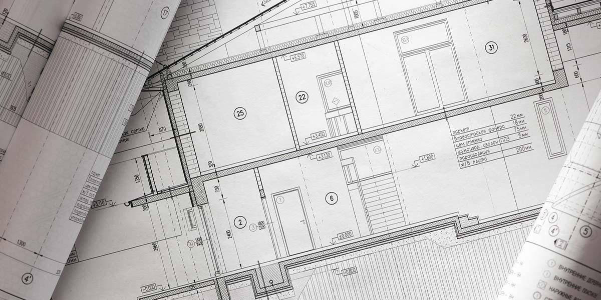 A set of blueprints show the structural design of a home.