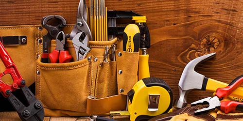Various construction tools sit on a table.