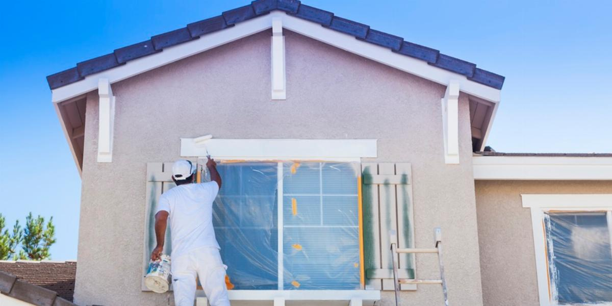 Man Painting Home Exterior.