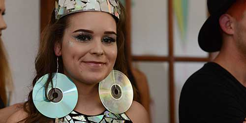 A Dress, Tiara and Earrings Made of Old CDs is Modeled at the ScrapsKC ReVision Upcycled Fashion Show.