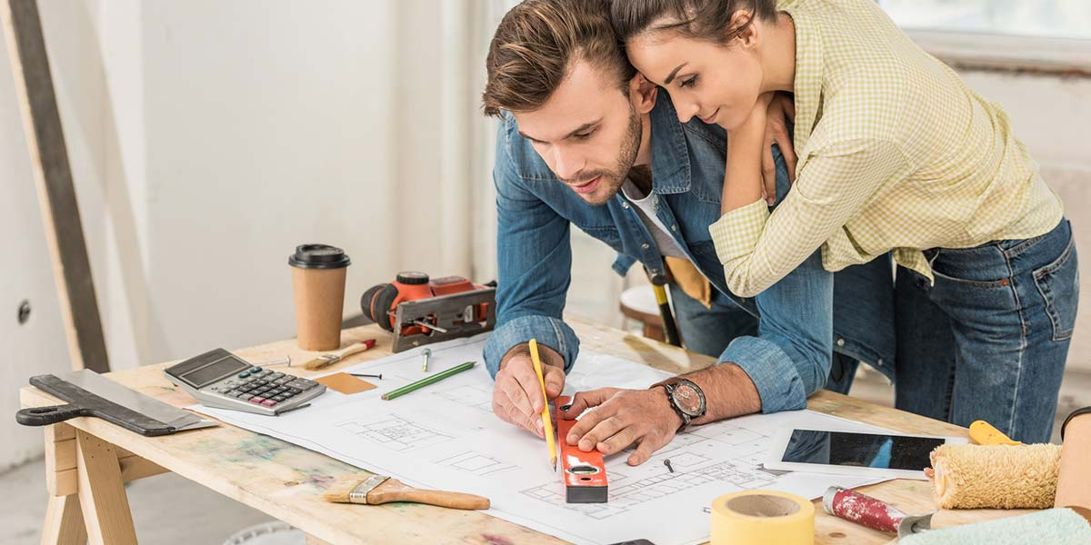 Couple Looking Over Home Improvement Plans.