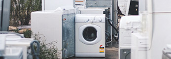 old washer and dryer with other junk