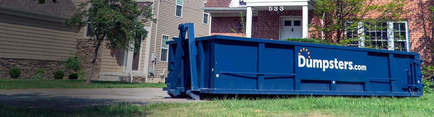 20 yard dumpster in residential driveway