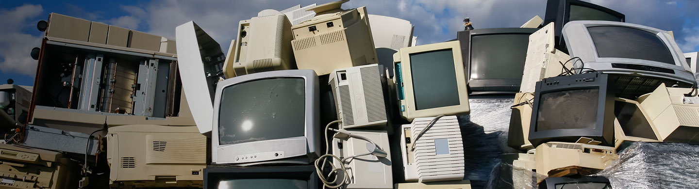 heap of old computer monitors and other electronic waste