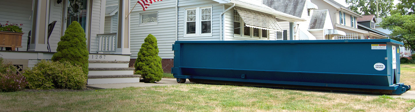 Roll off dumpster for roofing material.
