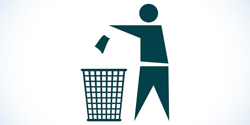 Image of Person Throwing Trash in a Trash Can
