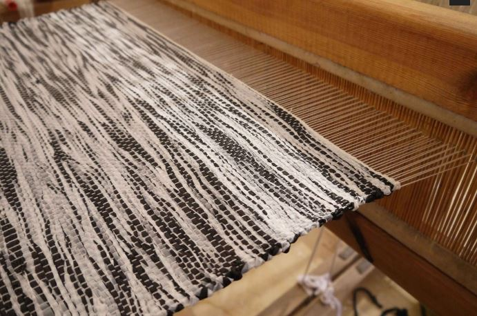 Black and white Plastex being woven.
