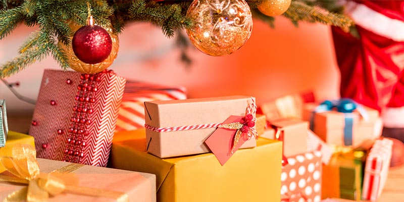 Christmas Gifts Under Tree High-Res Stock Photo - Getty Images |Wrapped Christmas Presents Under The Tree