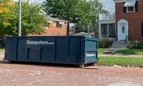 Side View of a Blue Temporary Dumpster With a Dumpsters.com Logo